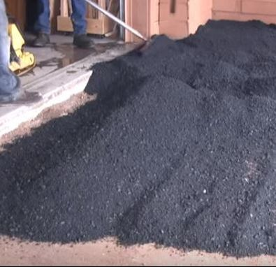Laying Hot Asphalt Mix Next to Garage